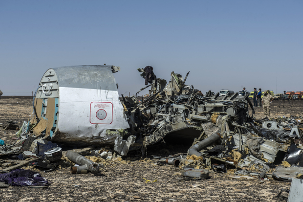 Debris of the A321 Russian airliner lie on the ground a day after the plane crashed in Wadi al-Zolomat, a mountainous area in Egypt's Sinai Peninsula, on November 1, 2015. International investigators began probing why the Russian airliner carrying 224 people crashed in the Sinai Peninsula, killing everyone on board, as rescue workers widened their search for missing victims. AFP PHOTO / KHALED DESOUKI        (Photo credit should read KHALED DESOUKI/AFP/Getty Images)